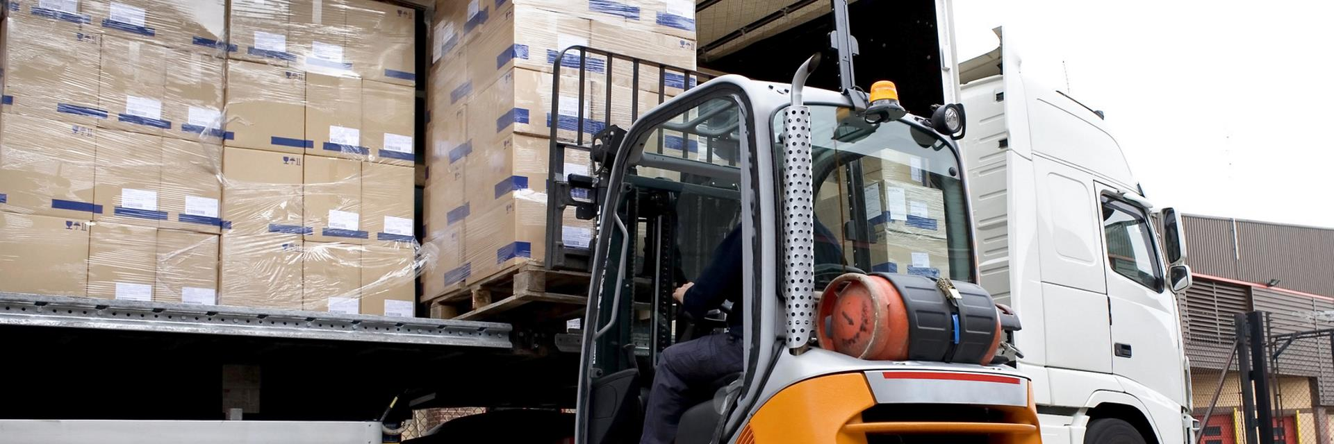 Forklift driver loading pallets onto a trailer for onward distribution
