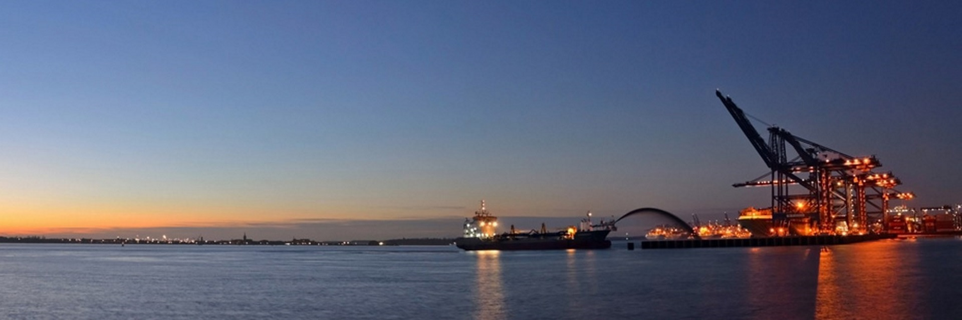 port of Felistowe at sunset - container ship loading