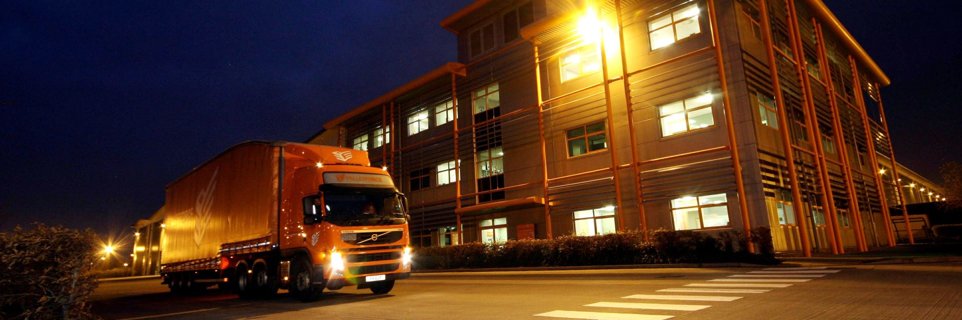Pallet Force Service - Night View of Delivery Trailer